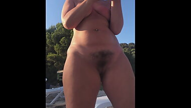 Hot hairy milf enjoy the sun on the beach