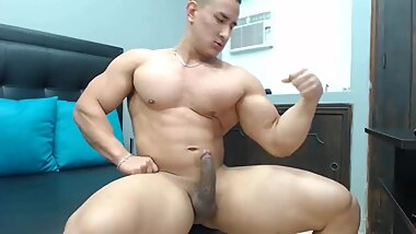 COLOMBIAN HUNK JHON CURT FLEXES HIS MUSCLES AND SHOOTS HUGE AMOUNTS OF PRECUM BEFORE CUMMING